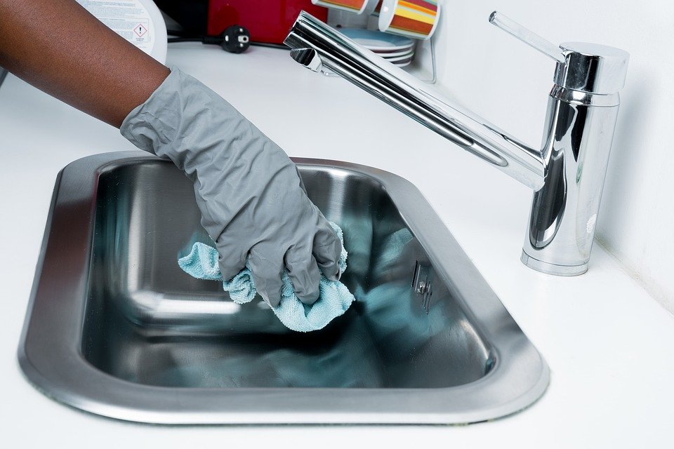 Use gloves when cleaning the house while sick to prevent spreading germs.