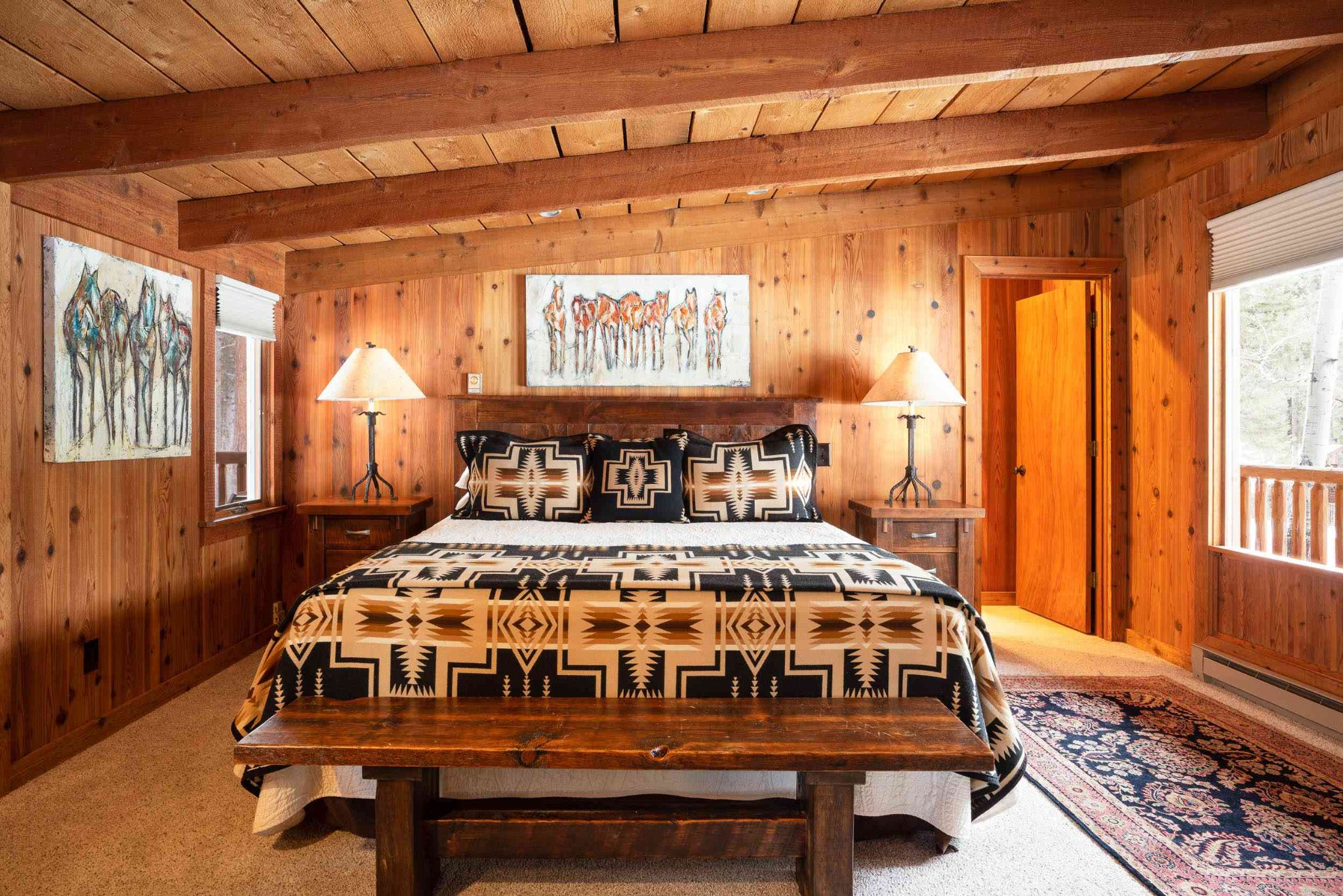 cabin bedroom with boho canvas and bedding