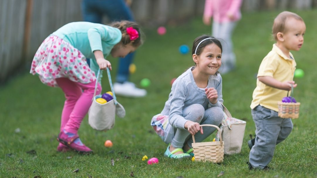 group of children doing an Easter egg hunt during Holy Week