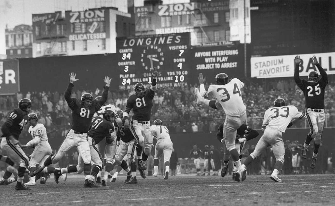 On the field action between the Chicago Bears (in dark colors) and the New York Giants during the championship game at Yankee Stadium, Bronx, 1956.