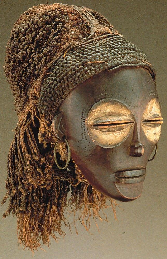 Female (Pwo Mask). Chokwe Peoples. Wood, fiber, pigment, metal.