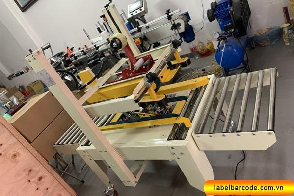 máy dán thùng carton fxj6050 tại an thành