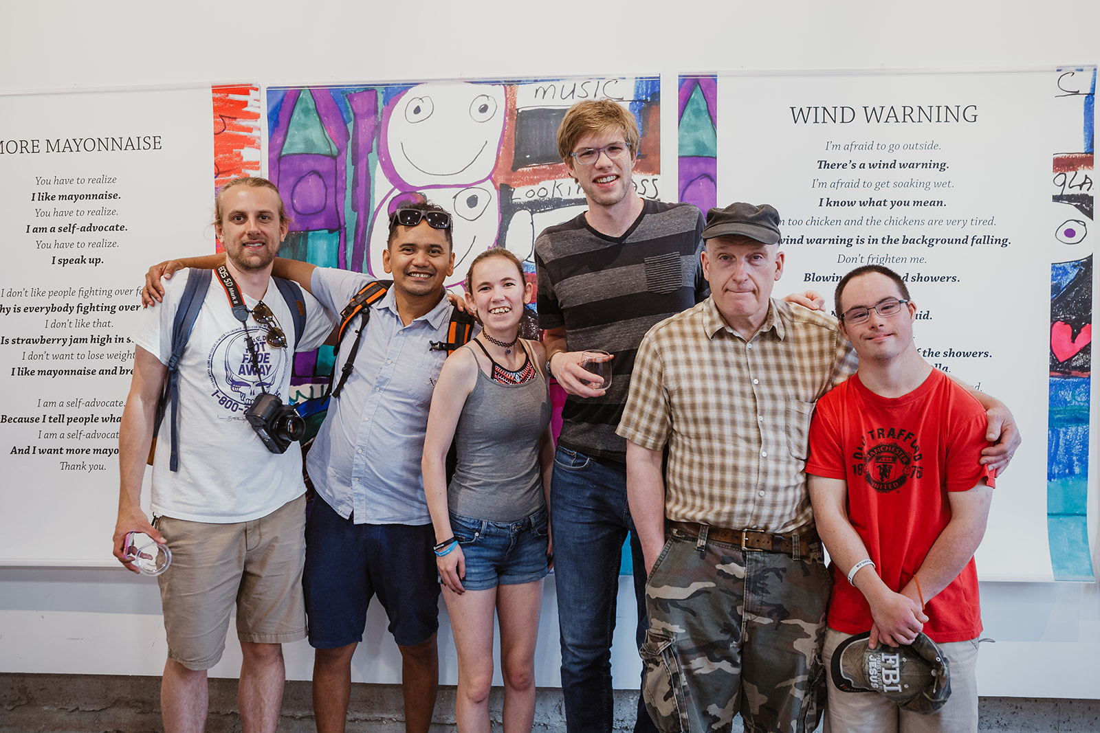 Six visitors stand in front of Teresa's 'Wind Warning' artwork at the opening of Born To Represent on July 22, 2019. Photo: This Is It Studios.