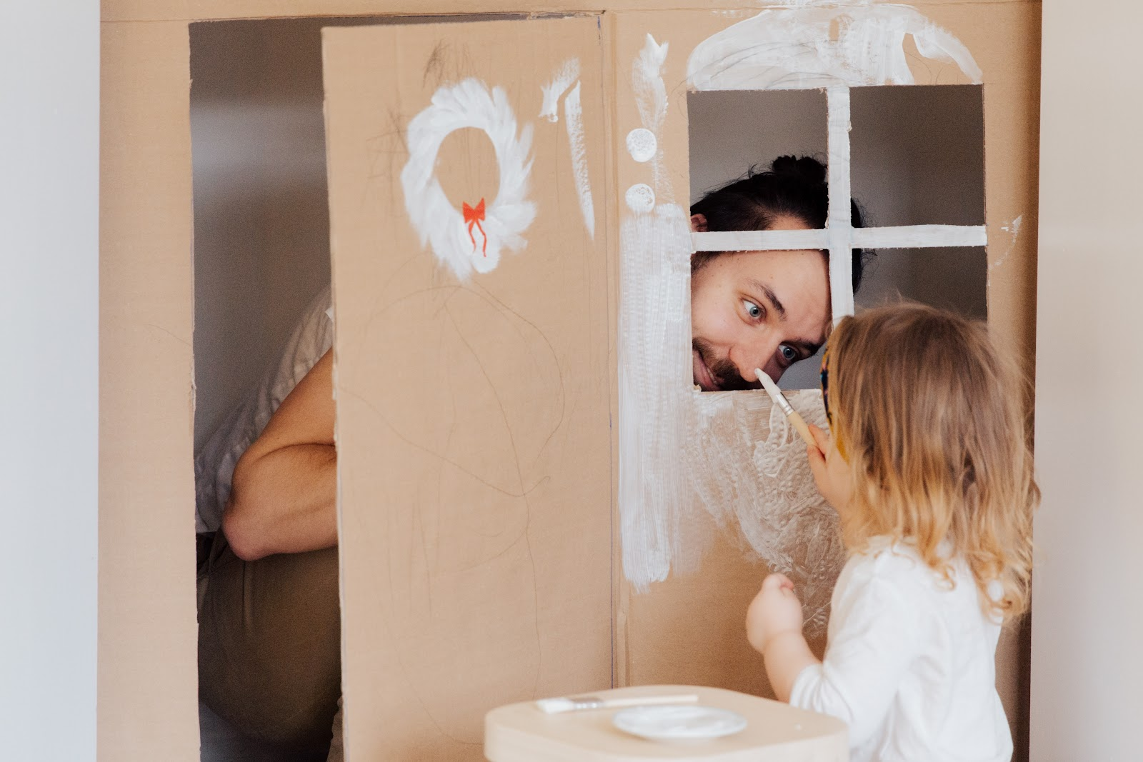 dad and child painting props for at home photo booth