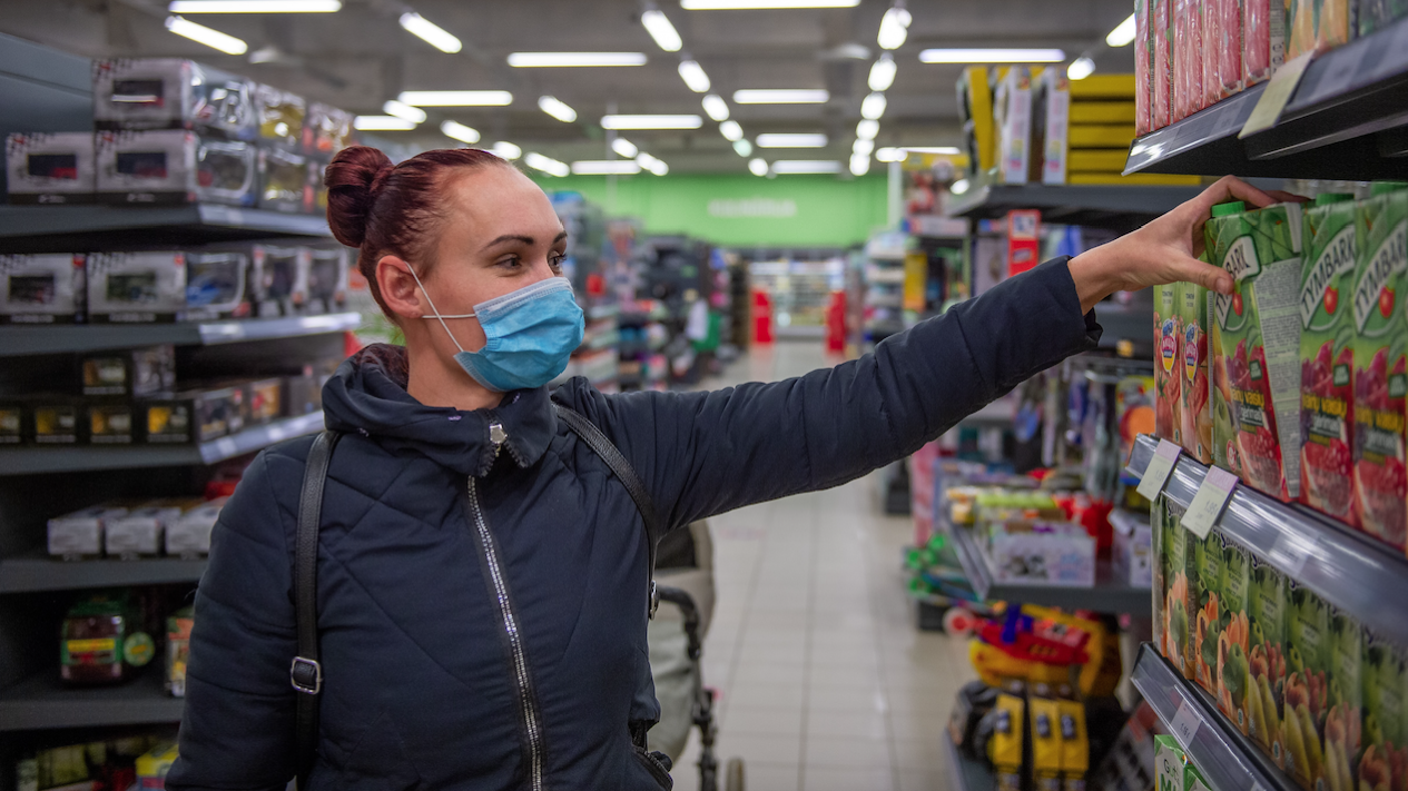 Modern 2021 shopper wearing face covering.
