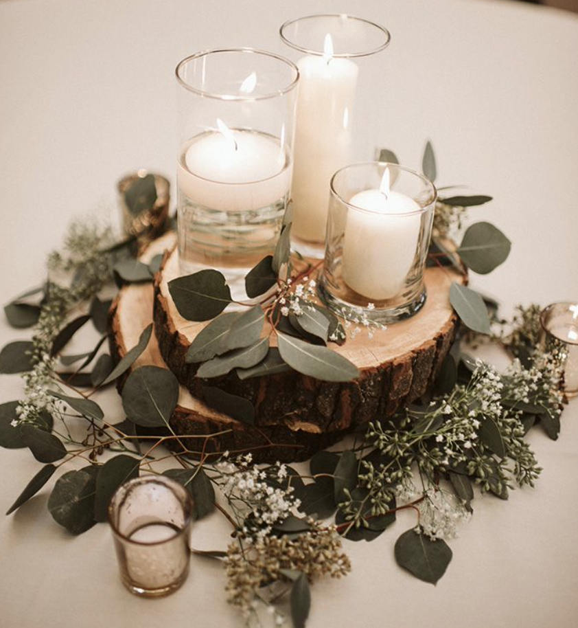 wood plaques with candles and flowers