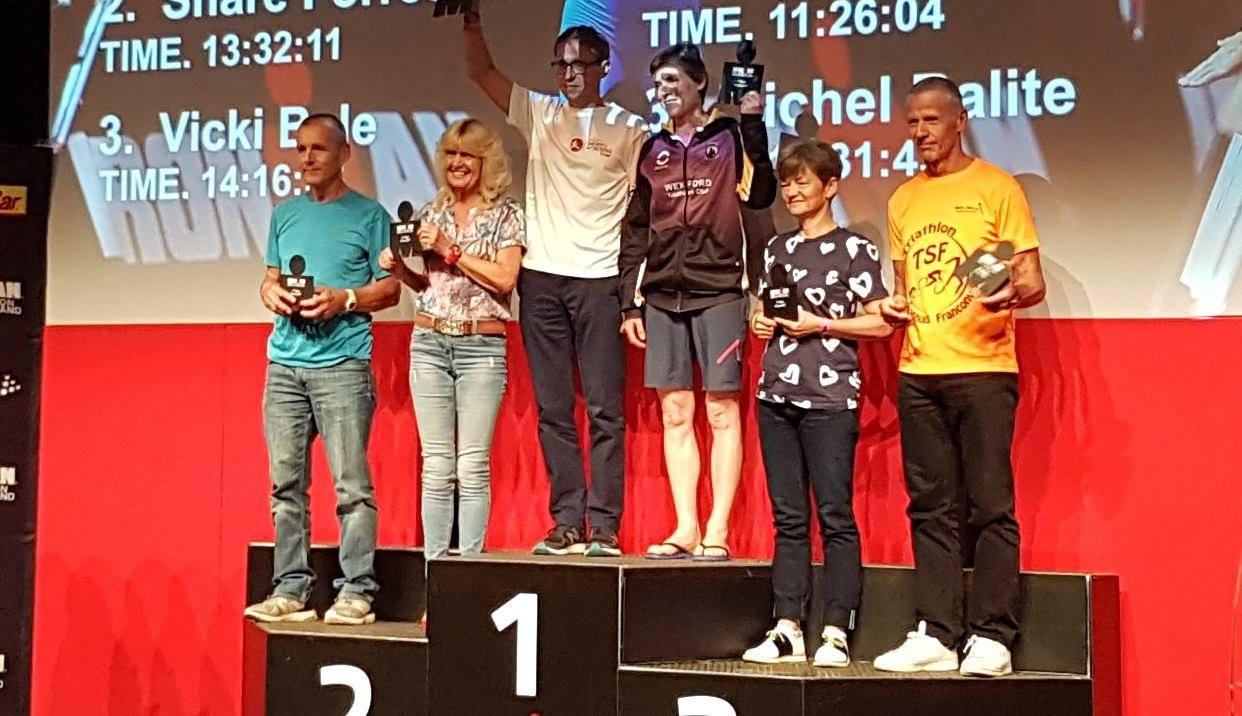 Ironman UK Jarosław Grzelec na podium.jpg