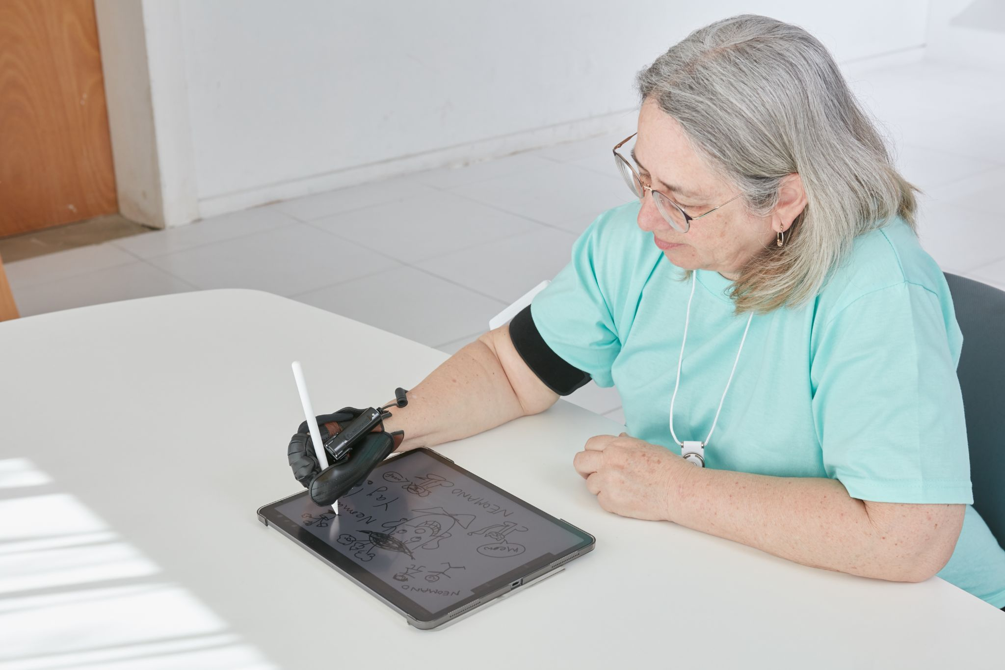 Neofect Neomano - wearable and soft robotic glove that enables people with hand paralysis to complete daily activities