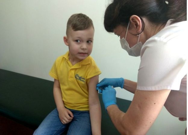 A boy being vaccinated in Lviv