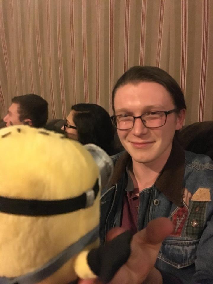 Image may contain: Zach Schauffler, smiling, eyeglasses