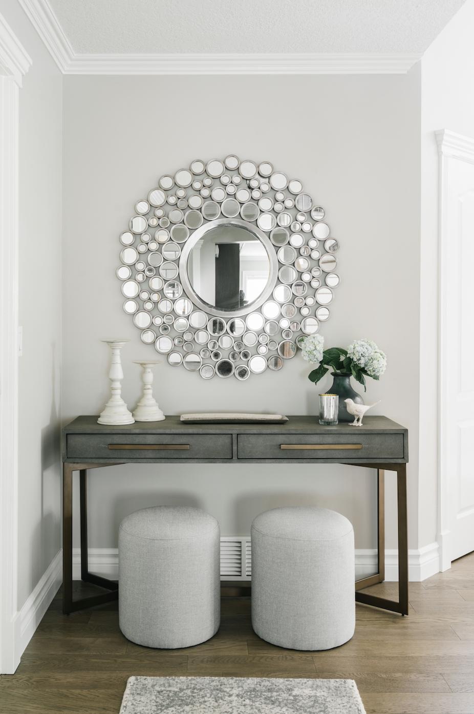 circle mirror ottomans candlesticks vignette desk silver matter brass calgary design