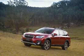 Red Subaru Outback Driving in The Field