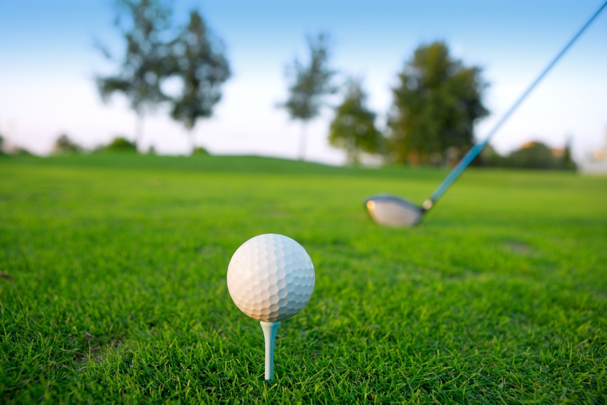 stockfresh_634113_golf-tee-ball-club-driver-in-green-grass-course_sizeS.jpg