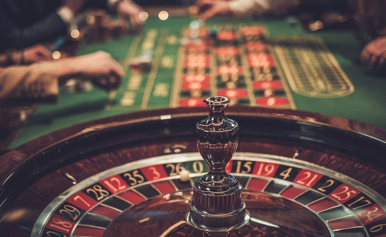 Gambling roulette table in casino.