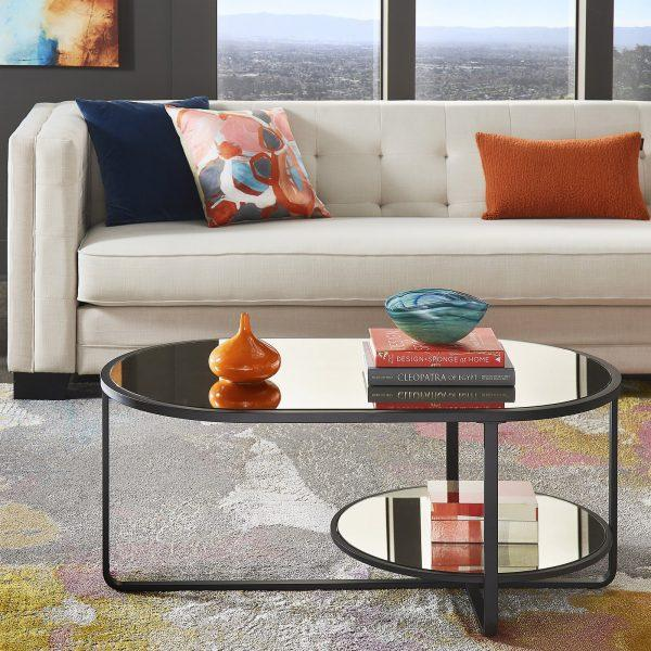 http://cdn.home-designing.com/wp-content/uploads/2021/04/oval-mirrored-coffee-table-with-circular-display-shelf-matte-black-frame-unique-modern-living-room-furniture-online-600x600.jpg
