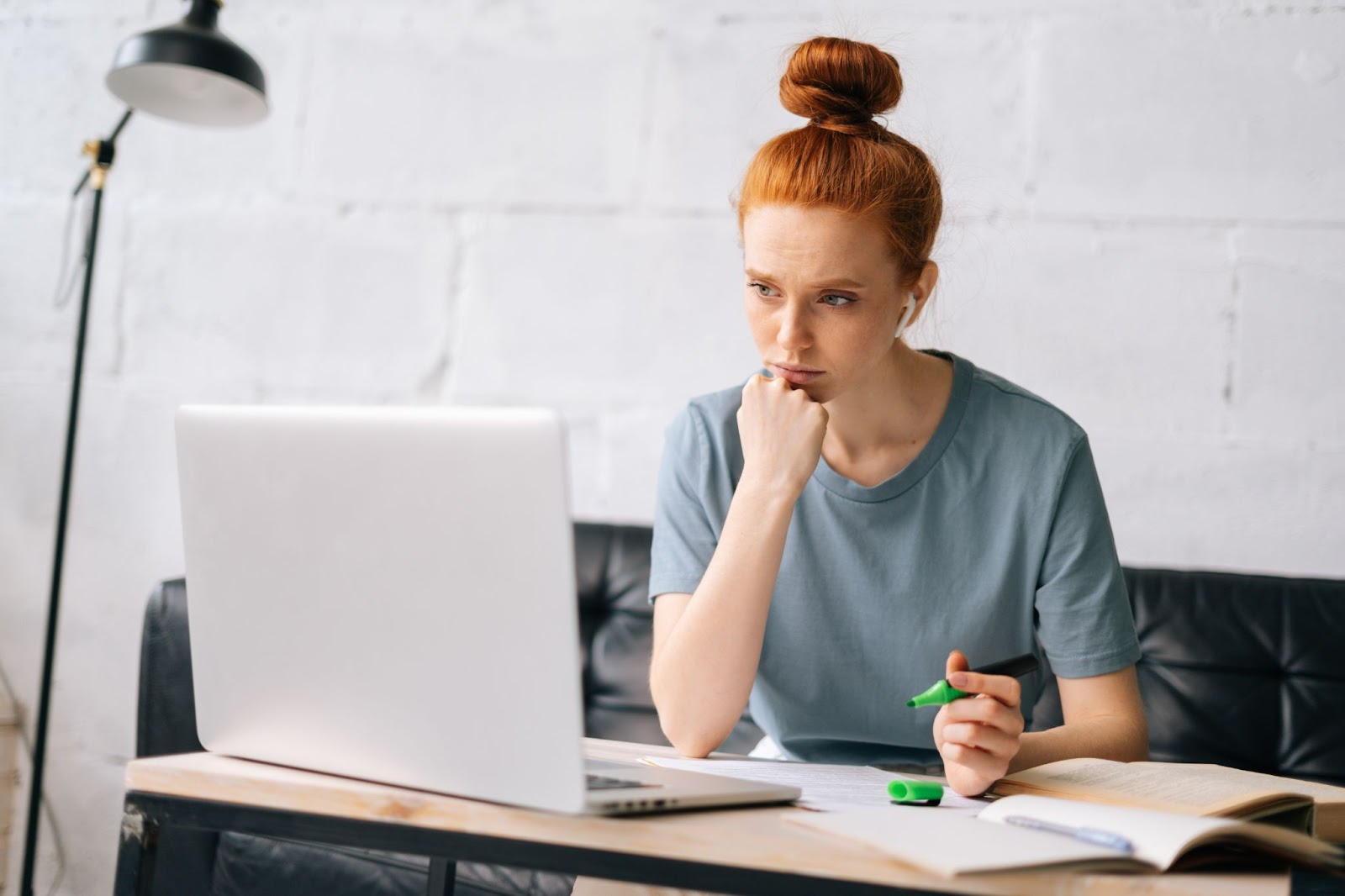 best preferred stocks: woman looking at the laptop