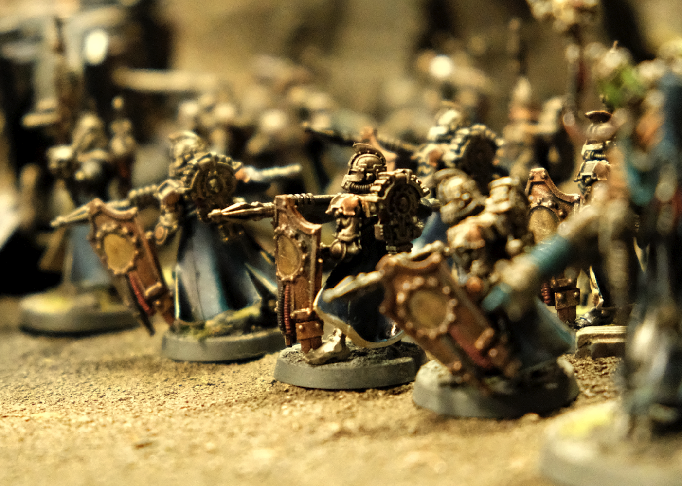 Skitarii miniatures armed with spears an shield laid out for a game of Warhammer 40k