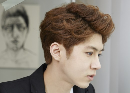 Young, Asian male with brown, wavy, side-parted hair
