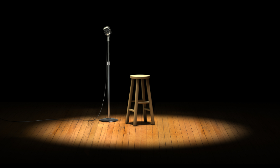 Empty microphone and barstool with spotlight
