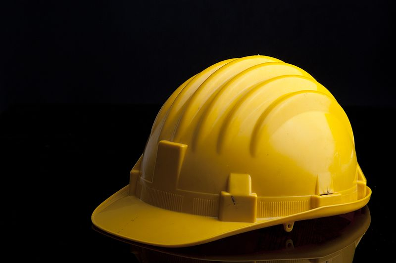 yellow safety hat a part of health and safety regulations