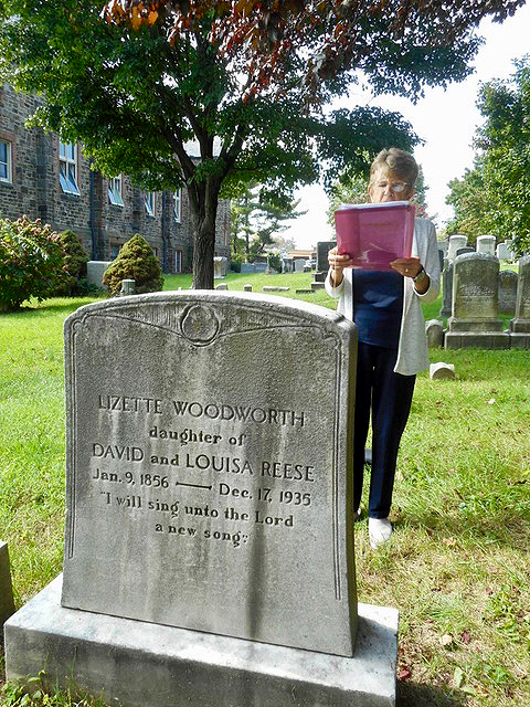 Council woman Mary Pat Clark reading poetry at the gravesite  of Lizette Woodward Reese during Doors Open  2018