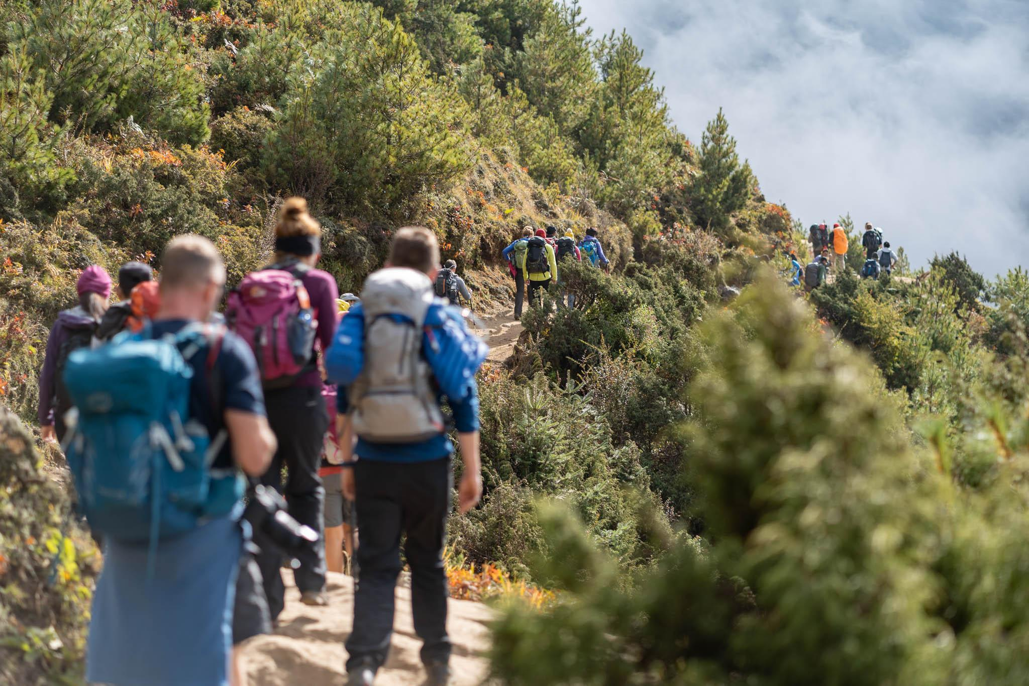 A Bucket List group on a mountain trail