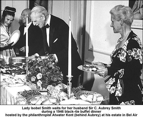 Aubrey Smith and his wife at a party in 1946.