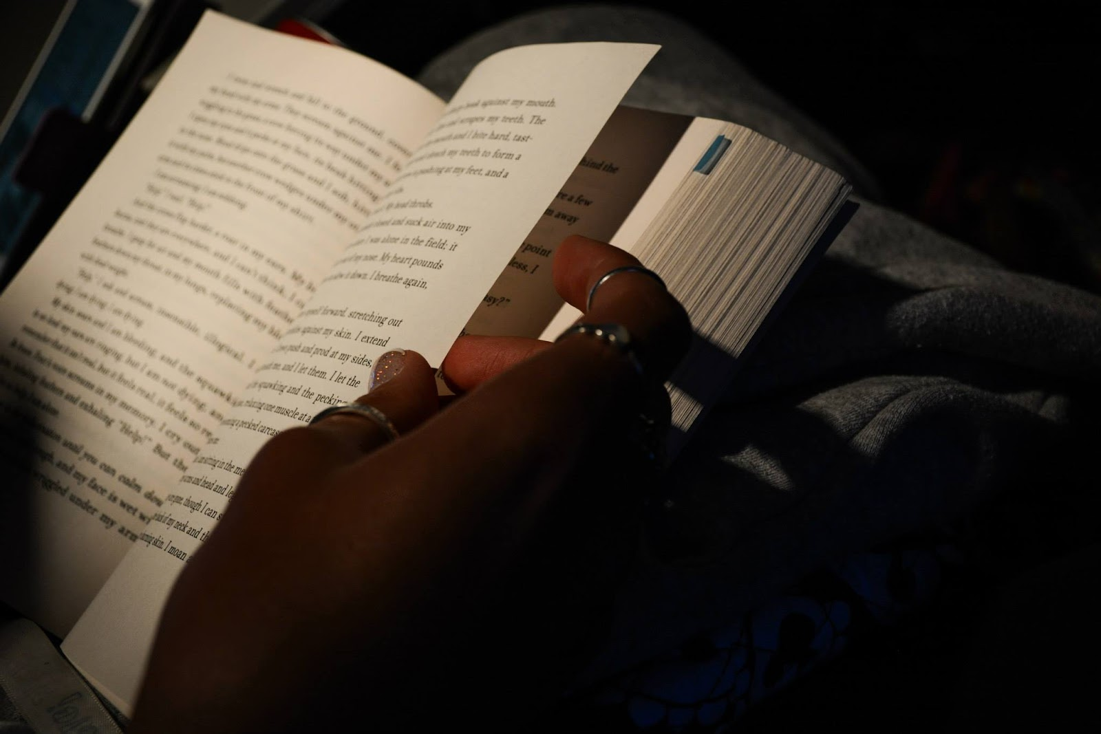 Hand turning a page of a book