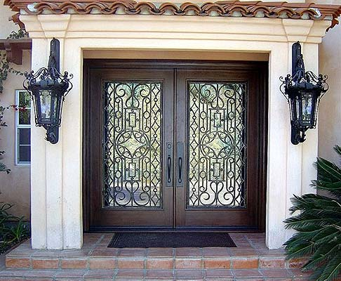 ... this double-wide fortress door uses some uniquely artistic window panes in becoming one of the more elegant fixtures on this list. & 9 Doors with Personality and Bonus Door Montage