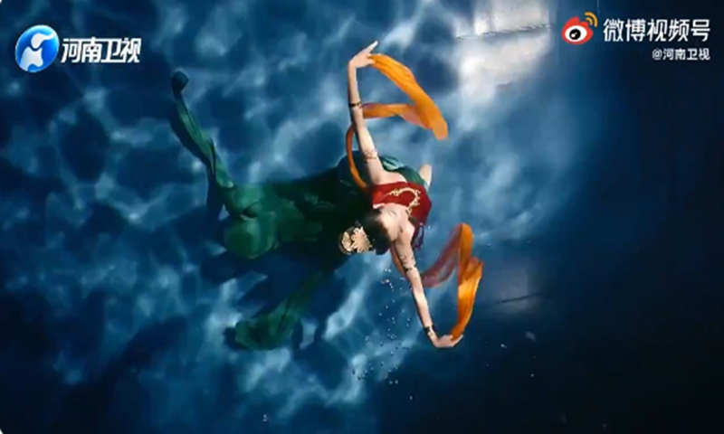 Woman performs classical dancing in the water. Her beautiful moves and flowing dress draw to mind Luoshen, a mythical Chinese water goddess. Photo: screenshot on Sina Weibo