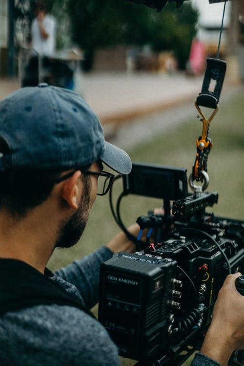 Man Holding Video Camera 5 Tips for Choosing a Good Film School
