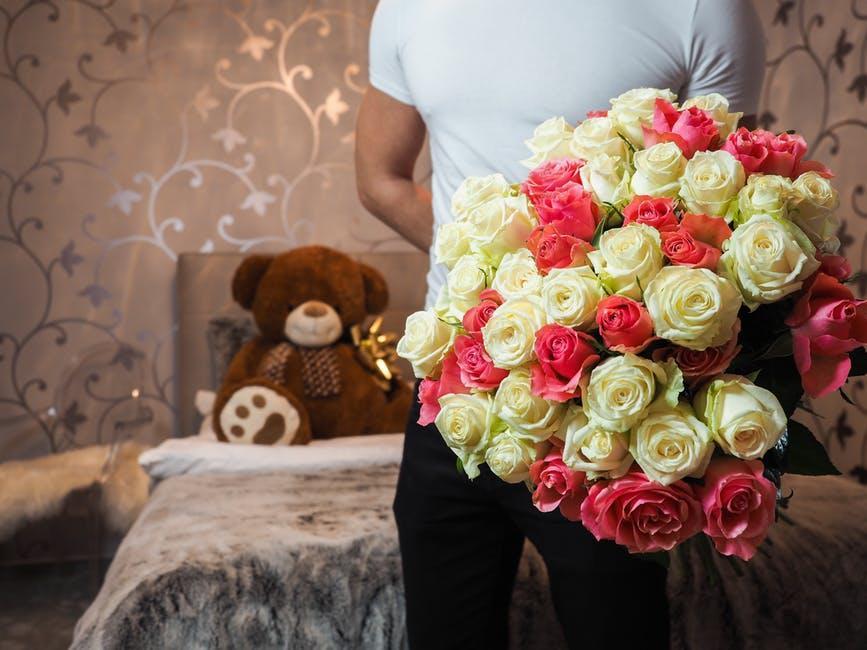 Man Holding Flower Bouquet