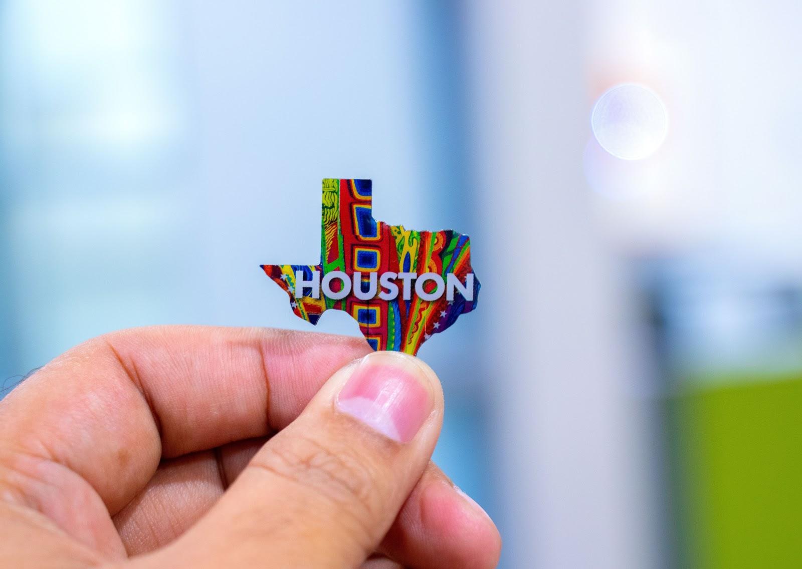 Texas-shaped pin that says Houston.