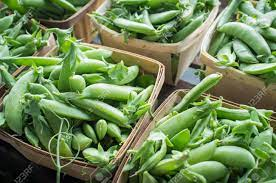 Close Up Organic Snap Peas In Baskets At Local Farmers Market Stock Photo,  Picture And Royalty Free Image. Image 59924570.