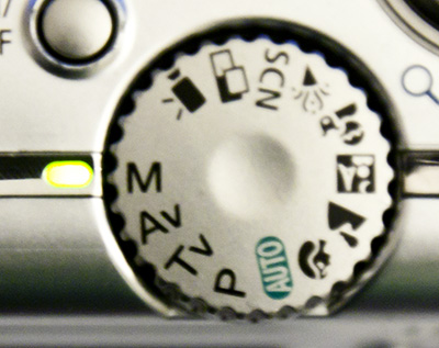 Camera mode dial in a point and shoot digital camera