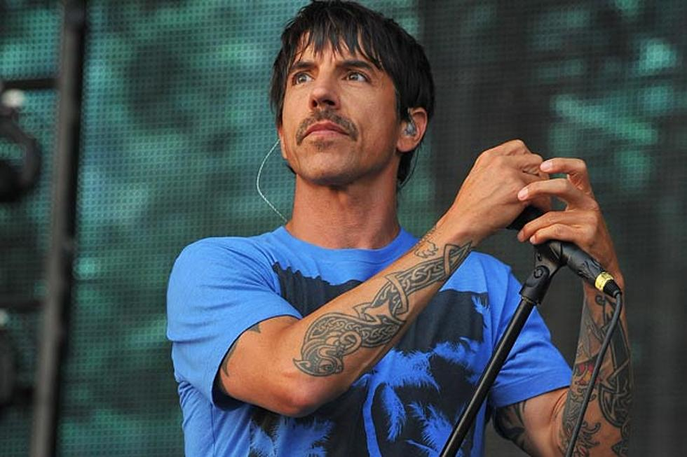 Anthony Kiedis performing at a concert.