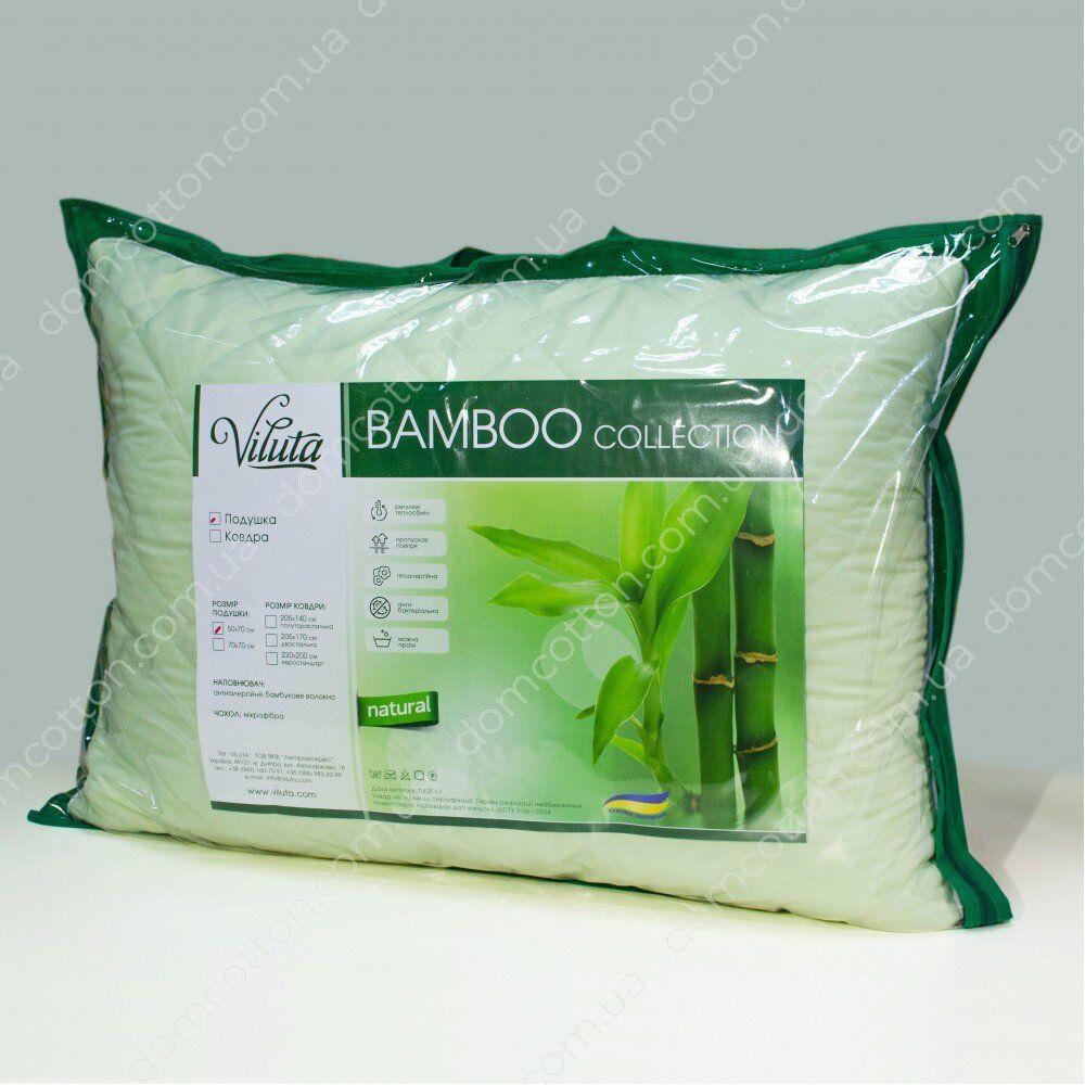 Подушка из бамбука в зеленом чехле