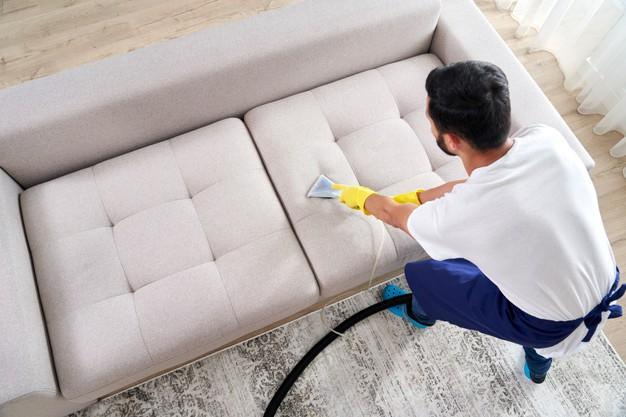 close-up-housekeeper-holding-modern-washing-vacuum-cleaner-cleaning-dirty-sofa-with-professionally-detergent-professional-springclean-home-concept_130111-3787.jpg