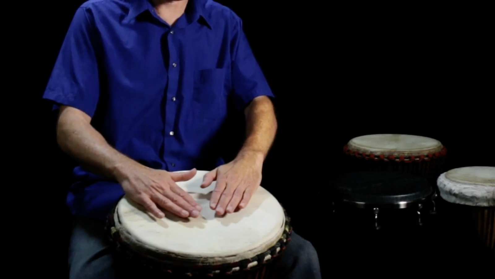 hands placed on drums