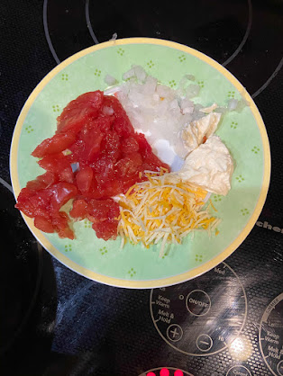 This is a small dessert plate. It looks like more than it is. The shredded cheese is exactly 1 Tablespoon.