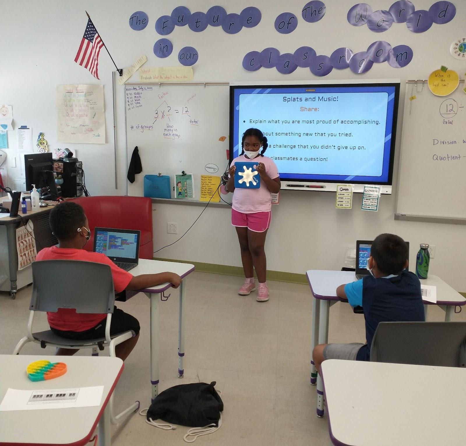 student presenting her program