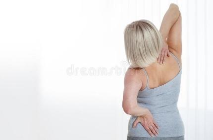 Middle aged woman in pain holding her backache. Woman in pain holding her backache. Concept photo with indicating location of the pain. Health care concept royalty free stock images