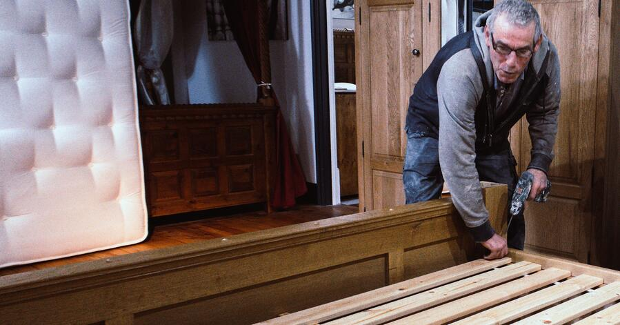 Measuring and placing the slats on one of our solid wood beds