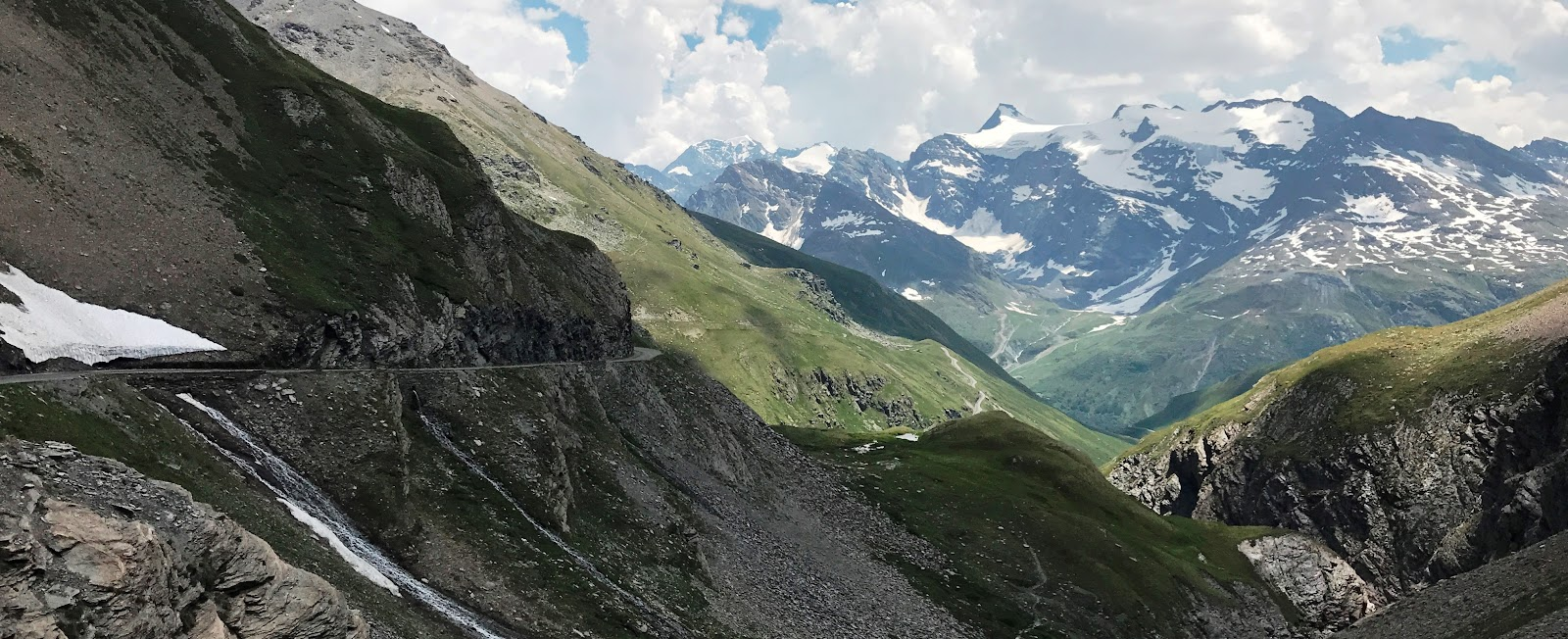 Climbing Col de L'Iseran from Bonneval-sur-Arc by bike; narrow road and cliff