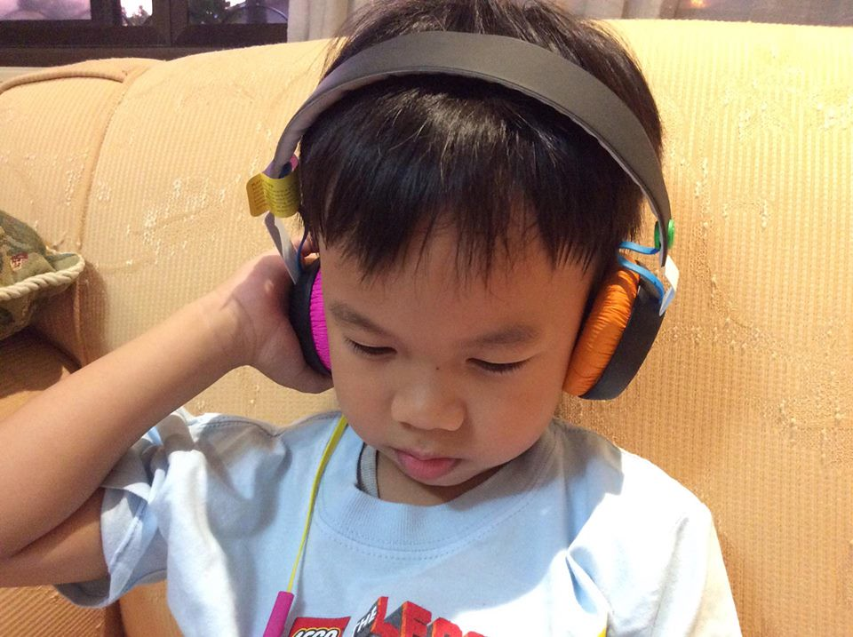 A kid wearing headphones (From: townsquarecentral.org)