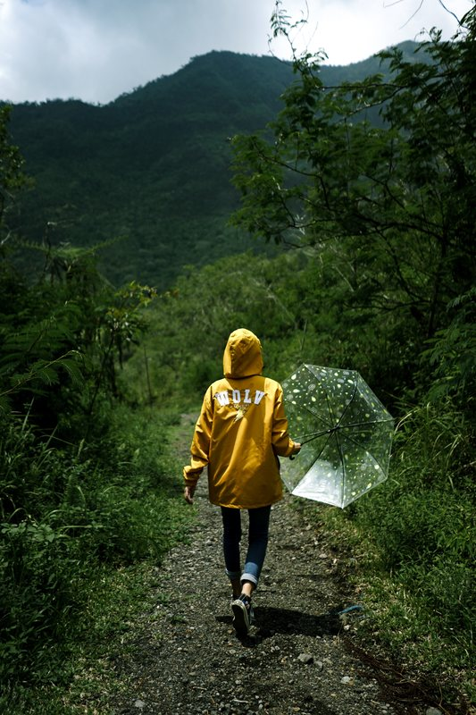Woman hiking through foresty mountains - How to Plan a Weekend Trip