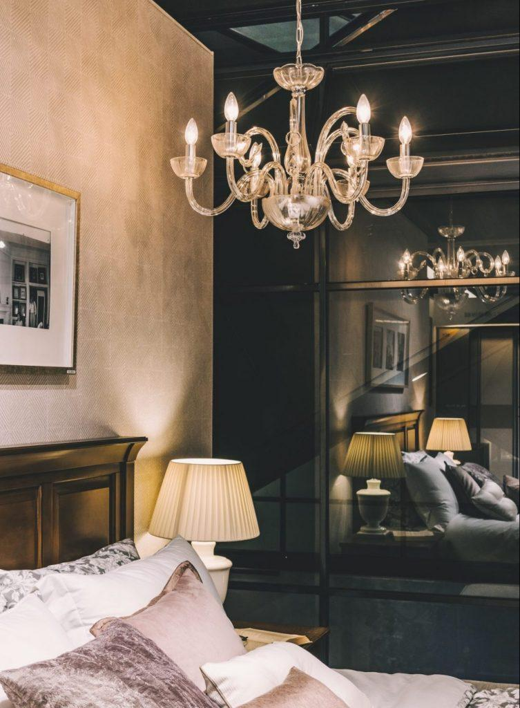 A chandelier in a bedroom.