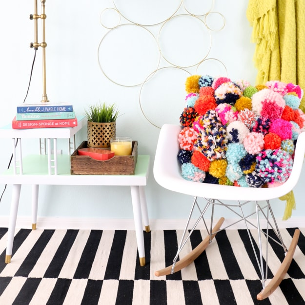 DIY bed pillow: Colorful pom-pom pillow on white chair
