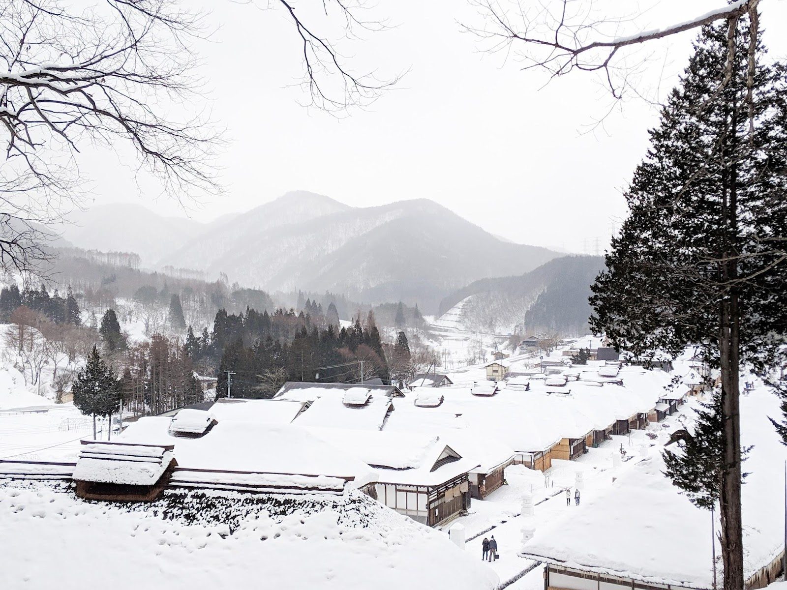 Cabins in Ouchi-juku covered in snow.