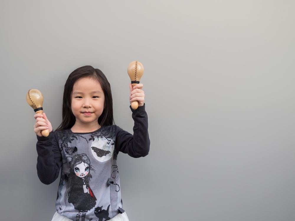 ../../Desktop/stock-photo-little-asian-child-play-the-maracas-gray-background-582763411.jpg